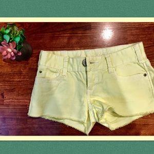 NWOT yellow Aeropostale frayed shorts.